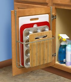 This over-the-cabinet organizer so your cutting board doesn't have to get crammed into a drawer or oven hole. | 25 Useful Things That Will Actually Help You Get Your Shit Together http://amzn.to/2pfvyHP