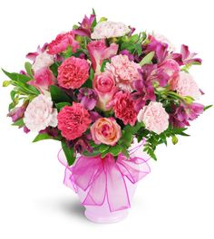 "It's ""berry"" beautiful! Rosey pink and purple hues are a scrumptious combination, perfect to send for any special occasion.   A colorful bounty of pink roses, pale pink and fuchsia carnations, and deep mauve alstroemeria is sure to be a hit. A pastel pink vase and a bright pink ribbon complete the look!"