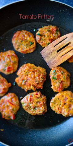 Tomato Fritters with feta are a little crispy on the outside and quite moist and full of flavors on the inside. Perfect for summer parties!