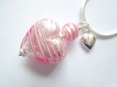 Pink and silver Murano glass heart pendant with sterling silver charm and chain. £39.00