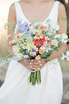 This bridal bouquet mimics the look of wildflowers with hues of coral, lavender, pink, and yello. Rustic Wedding Flowers, Flower Bouquet Wedding, Floral Wedding, Wedding Colors, Wildflowers Wedding, Wedding Lavender, Rustic Bouquet, Pink Bouquet, Lavender Bouquet