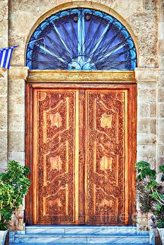 A couple of old style ornate wooden doors situated on the greek island of crete. Please click the 'LIKE' & 'VOTE' icon if you really like this image enough to repin it. Thanks.