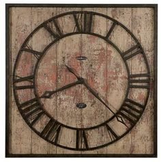"""This large 35"""" square rustic wall clock features a grooved background, aged and distressed to resemble weathered wood planking. The square, metal frame and applied metal rings and numerals are finished in aged charcoal black iron. The dial has Roman numerals, aged charcoal black hands with open cut diamond tips and features Ty Pennington's signature. Quartz, battery operated movement. Size: H. 35"""" W. 35"""" D. 2-3/4"""""""