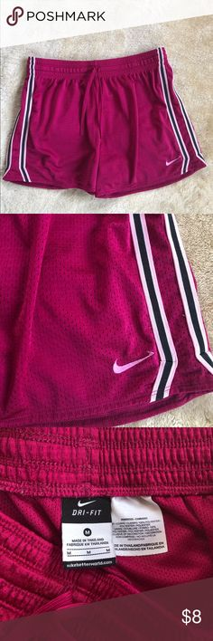 Nike Gym Shorts Women's Nike dark pink gym shorts. Like new condition with waist drawstrings. They're the perfect length in my opinion- not too short and not too long! Check out my other shorts and bundle to get at least 20% off!! Nike Shorts
