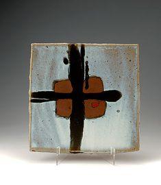 Ceramics by James Hake at Studiopottery.co.uk - 2009. Square dish on raised feet. Nuka and Kaki with tenmoku cross. 35cm.
