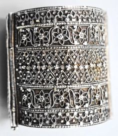 "A truly splendid (and rare) Yemeni silver cuff. Jewish work, 19th century. Detailed and delicate but not sickly or ""over the top"". By Linda Pastorino, and we have bought it from her for our own collection. Looking forward to seeing it in real life in the near future! As this is to our minds a really satisfying example of remarkably beautiful (and somewhat unusual) Yemeni jewellery at its best, and hard to obtain, we are very excited by this new acquisition."
