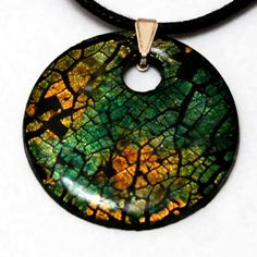 Fimo/Polymer Clay mixed with metal leaf and alcohol inks can create some stunning effects.