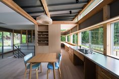 Green and Live House designed by Akka in Nara, Japan. A contemporary architectural structure surrounded by green trees and foliage.