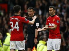Manchester United's Giggs comes on as a substitute for teammate Lawrence during their English Premier League soccer match against Hull City ...