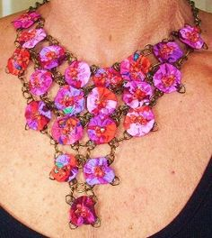 Yoyo bib necklace   My sister could pull this off because she's not afraid of the big embellishments
