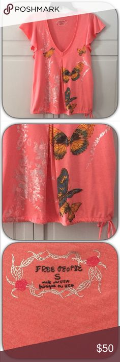 """NWOT """"Free People"""" Whimsical Orange Coral  Top This is a super pretty whimsical sparkle Foil butterfly top! It is a true gem! The colors are so beautiful! It has an adjustment tie on the bottom! You can leave it as loose as you like! This is a small but would be fine on a medium too! Free People Tops Tees - Short Sleeve"""