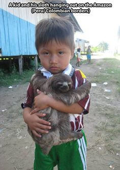 I would have  a much happier look on my face if I had a sloth for a pet :)