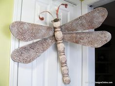 Dragonflies made from old ceiling fan blades, table legs or banister rails. :)
