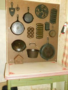 Display cast iron collection on a peg board