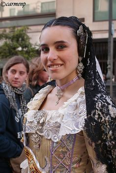 "From 14th March we are living in Valencia (Spain) the tradicional celebration of our city. This is a picture of my friend Alba dressed with the traditional dress, hair and jewels during ""La Ofrenda"", which people dressed with that dresses goes to offering flowers to the virgin and then the Virgin's body is constructed with flowers."