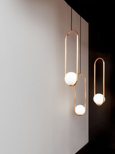 To create as minimal a form as possible, Matthew McCormick designed the lamps so that all the wires and technology are neatly concealed inside the frames.