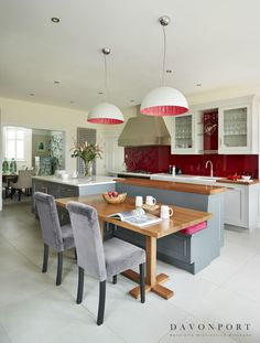 With three young children it was important to ensure the kitchen was ready for family life. Our clients felt that they wanted an area in the kitchen that was safe for their children to sit whilst they cooked. The dining area integrated at this end of the island forms the perfect space for the children to relax and play away from the hobs and ovens.