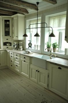 Rustic Cottage kitchen, wood counters, cream cabinets, pendent light, farm sink...