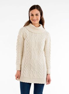 Patricia Aran Cowl Neck Sweater - With a tunic style, the Patricia has an elongated shape with a luxurious, cozy and supersoft feel. The thoughtful silhouette makes a statement that is both flattering and feminine. The exquisite cable, moss and basket stitches derive from the Celtic legacy of the Aran Islands where women skillfully created Aran sweaters.