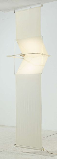 """A """"Quinta"""" lamp by Silvio Coppola for Artemide. This light, with its length of 3 meters, can be used as a room divider or lighting courtain, hanging from the ceiling. This design received a """"Compasso d'Oro"""" award nomination in Light Art, Lamp Light, Light Bulb, Interior Lighting, Lighting Design, Loft Lighting, Deco Originale, Luminaire Design, Modern Floor Lamps"""