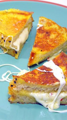 Mozzarella in a Coach (Italian Grilled Cheese)  (Mozzarella in Corrozza)    This is such a surprise... Seemingly a simple grilled cheese, but so much more.  Seemingly a grilled cheese made with French toast, but so much more.  More like a Bread pudding with a crispy crunchy outside, but the center is creamy almost custard like.  BEST EVER GRILLED CHEESE!!!