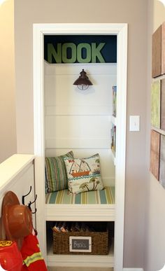 closet turned into a reading nook with book shelves
