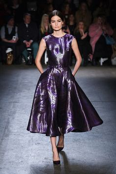 Christian Siriano, Fall 2014 A purple flare skirts shows a 50's pretty woman.