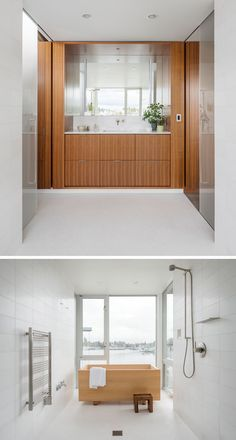 Hidden behind sliding frosted doors is this modern master bathroom. A wood vanity with plenty of storage is topped with white countertops and a large mirror. To the side of the vanity is a shower and a Japanese style hinoki tub (soaking tub) surrounded by white tiles, while large windows overlooks the lake.