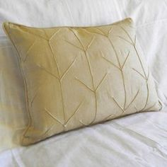 """Linen and cotton-blend throw pillow with arrow motif.Product: Pillow Construction Material: Linen and cotton Color: Fern        Features: Insert included    Dimensions: 16"""" x 20""""      Cleaning and Care: Machine washable"""