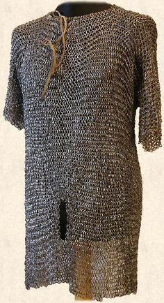 European (Slavic) riveted mail hauberk, 16th century, wedge shaped rivets with secondary modifications using round rivets. F4.