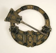 Brooch    Date:      early 20th century (original dated 8th or 9th century)  Culture:      Scottish  Medium:      Silver gilt, glass cabochons