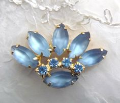 Vintage Blue Rhinestone Brooch by arepaki.etsy.com $12.00