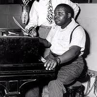"Joe Liggins (1915-1987) was an R & B, jazz and blues pianist, who was the frontman in the 1940s and 1950s with the band, Joe Liggins and his Honeydrippers.  His band was often a staple on the US Billboard R & B chart in those years, with their biggest hit being ""The Honeydripper"", released in 1945. That single topped the R & B chart, then called the race chart, for 18 weeks. During the 50's he played and recorded with Rusty Bryant's band for Dot Records."