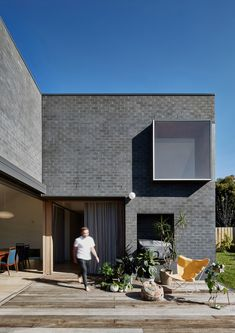 The best brick architecture and design, including a red brick theatre in Barcelona by Álvaro Siza and a dark-grey brick house in Belgium by Lezze. Grey Brick Houses, Modern Brick House, Melbourne Architecture, Brick Architecture, Brick Facade, Facade House, Brick Wall, Black Brick, Melbourne House