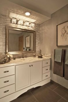 Beautiful materials - the finishes include an exquisite counter top made out of semi-precious quartz stones with a translucent quality; shimmery crystal vanity fixture; and beautiful glass tile used as a dominant accent in the vanity area.