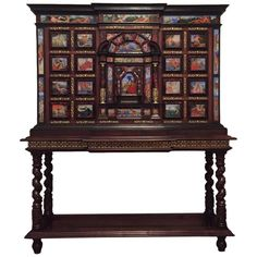 Original 18th Century Monumental Cabinet on Stand / Italian Bargueno / European. ca. 1790.  $174,000 (from $220,000.00). Important monumental cabinet on stand. The case of the cabinet is walnut, veneered with rich ribboned ebony and luxuriously decorated with turtle shell, bronze, carey. Bargueno with 49 glass paintings in bright colors, depicting gods of Olympus.