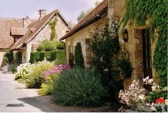 Apremont-sur-Allier. In the heart of Berry nestles Apremont , in a wooded landscape along the river Allier. Dominated by its castle surrounded by a floral park inspired by the English garden of Vita Sackville-West at Sissinghurst, the village was completely restored in the last century.