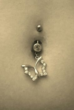 Butterfly belly button piercing
