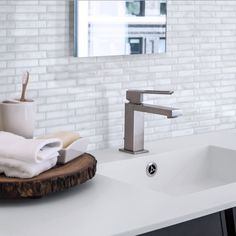 With its shades of white and grey, the peel and stick tile Milenza Bari by Smart Tiles illuminates the room and easily matches with everything around your backsplash Smart Tiles Backsplash, Peel N Stick Backsplash, Stick On Wall Tiles, Peel And Stick Tile, White Washed Furniture, Painted Brick Walls, Tile Covers, Adhesive Tiles, Tile Installation