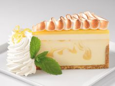 Lemon Meringue Cheesecake Topped with layers of Lemon mouse and Meringue