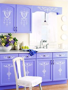 This looks so elegant! I like the stencils on the bottom cabinets better than the ones on the top though.