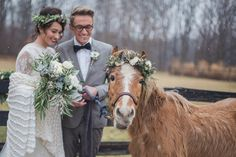 Winter wedding photo idea - couple pose with horse in flower + greenery crown {Conforti Photography LLC}