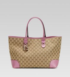 I don't usually like logo-drenched purses, but this 'Heart Bit Charm Tote' by Gucci is an exception.  I love the pink for spring!