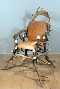 Chair made from antlers of a red deer.The seat and backrest are upholstered in cowhide.