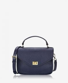 2f35d9161a Classic top handle satchel crafted in embossed Italian calfskin. Turn lock  closure and exterior back