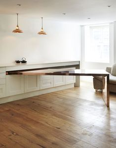 hide away dining table, i like this idea for small spaces,  architags: Atelier Chang. City Road. London.UK. photos (c) Atelier Chang