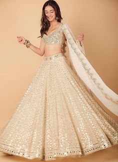 Ananya Panday makes a stunning statement in a gorgeous mirror work lehenga by Abhinav Mishra for Armaan Jain's wedding function. Party Wear Indian Dresses, Indian Wedding Gowns, Designer Party Wear Dresses, Indian Gowns Dresses, Indian Bridal Outfits, Indian Fashion Dresses, Party Wear Lehenga, Dress Indian Style, Indian Designer Outfits