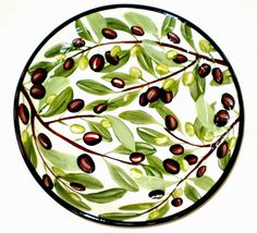 Olive pasta bowl, a current pattern painted by Geoff Graham in Vallejo, California at Cinnabar Ceramics.  You can google the Cinnabar Ceramics Website if you want to know more.
