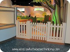 This links to a review of a children's museum but this is a cute idea for a baby gate in a large opening like the one in our house