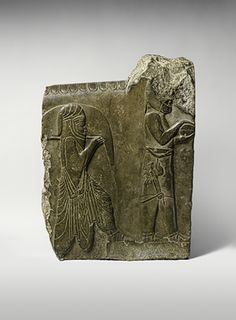 Relief: two servants bearing food and drink, 358–338 b.c.; Achaemenid period, reign of Artaxerxes III  Excavated at Persepolis, southwestern Iran  Limestone